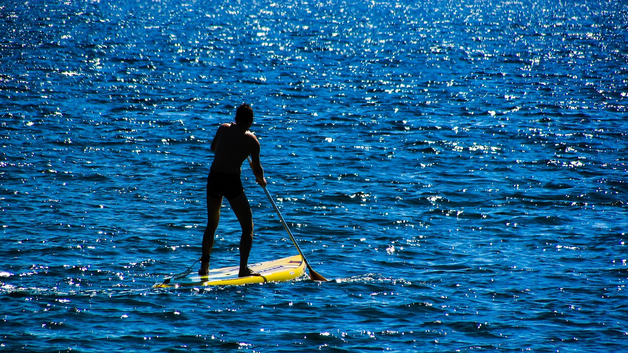 Surfer Paddle Board