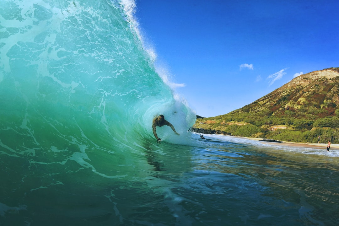 A person riding a wave on top of a mountain