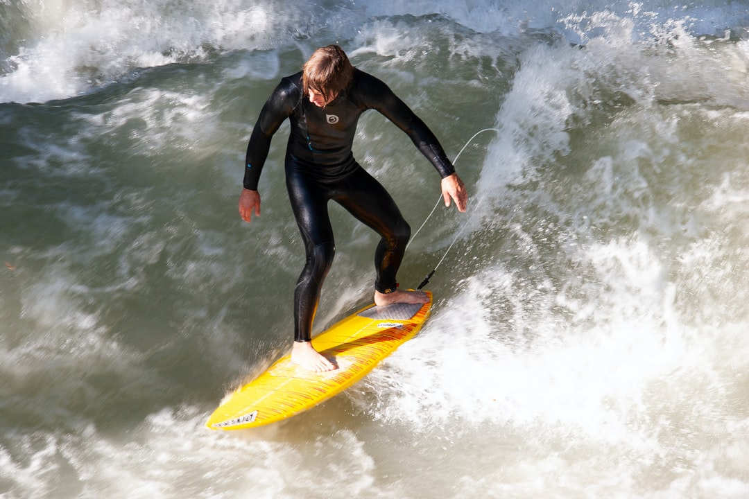 A woman riding a wave on a surfboard in the water