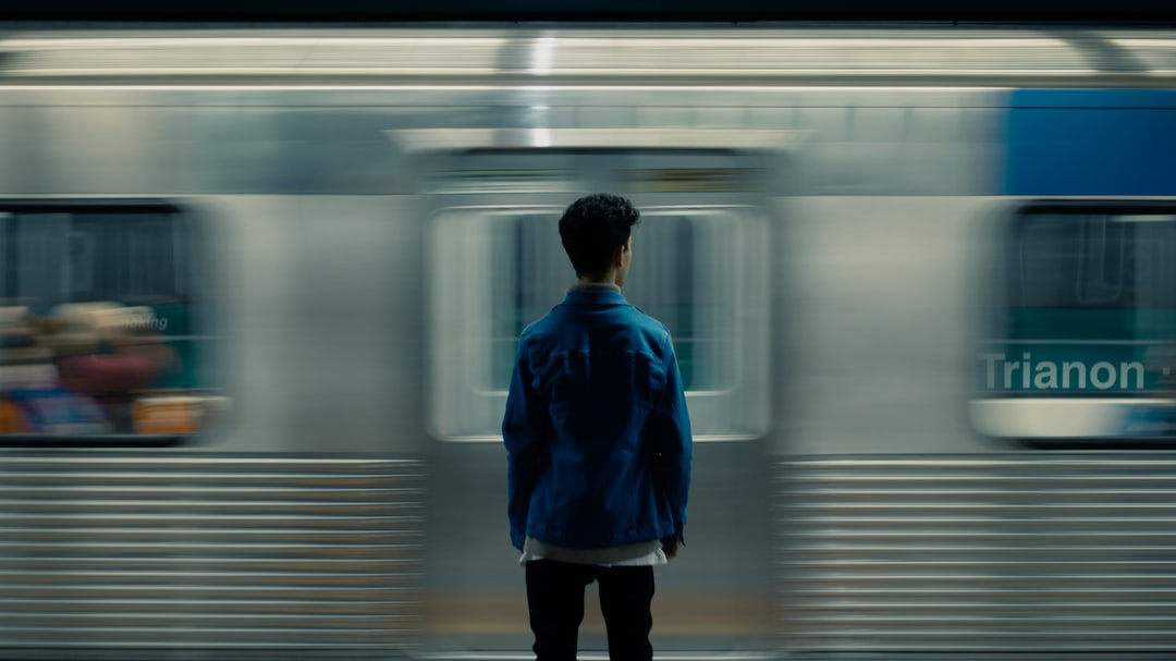 A person standing on a subway train