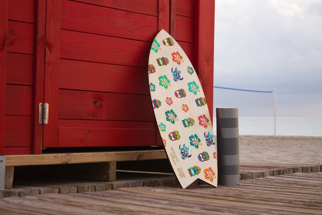 A person standing on top of a surfboard