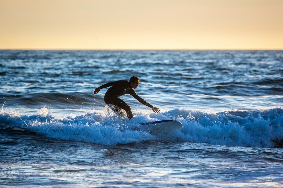 A man riding a wave on a surfboard in the ocean